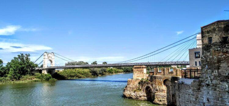 Fotos: L'Ebre, al seu pas per Amposta i el pont penjant